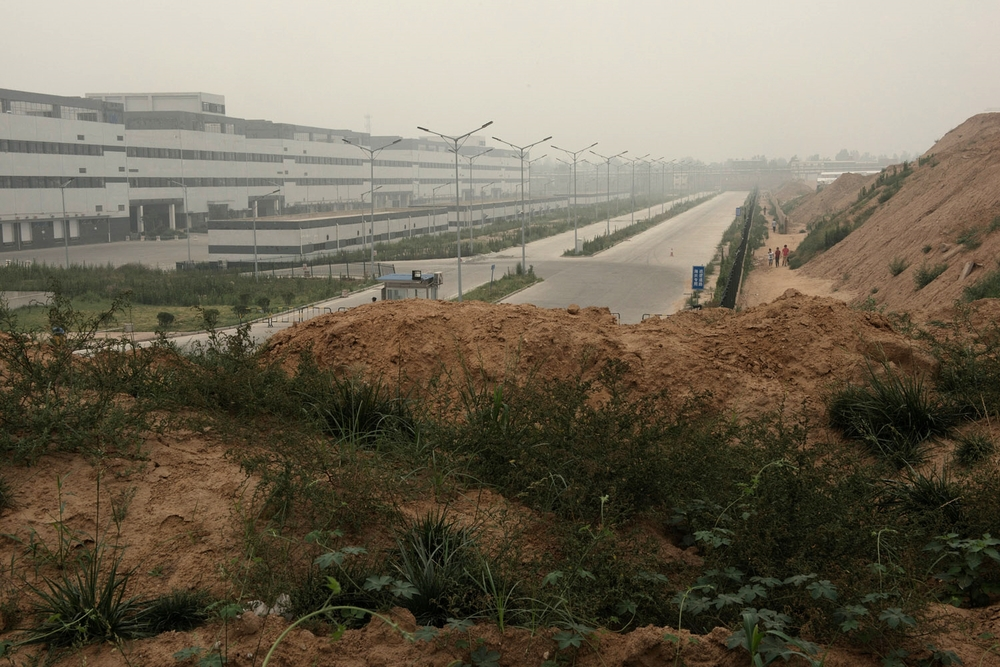 A Foxconn plant on the oustkirts of Zhengzhou. In the span of two years what was a group of rural villages has been transformed into a factory town with over 200 000 people mainly working at the production of Iphones. Foxconn, a Taiwanese company, is one of Apple main subcontractors and employs over 1.2 million people including hundreds of thousands in China.