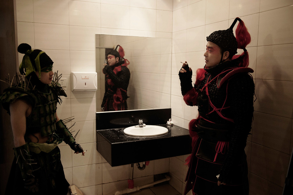 Actors smoking in the toilets during a break on a movie set.   Laws have been created to restrict smoking in public places but they are rarely enforced.