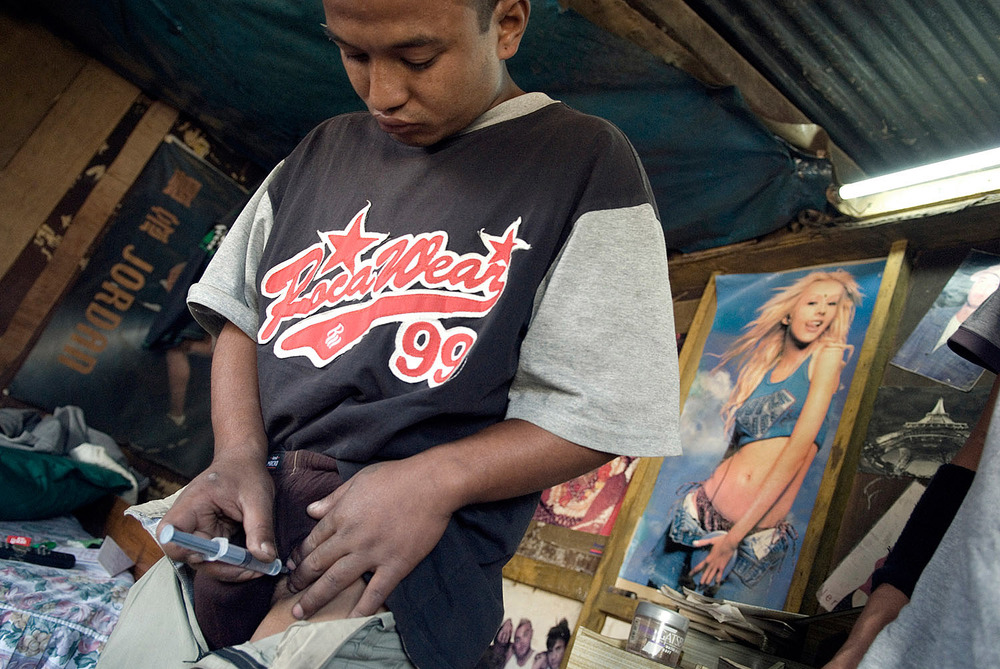 Biju a drug user, in his room, injecting himself Norphin, an addictive painkiller widely used in Nepal as a cheap replacement for heroin.