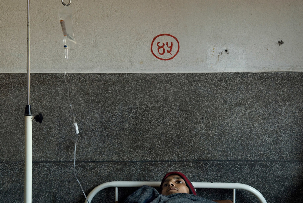 At Tekku hospital aids ward, Bijay, a HIV positive former drug user is laying on hisbed a few hours before his death.