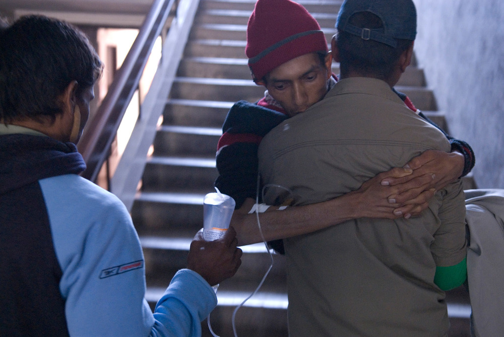 Suman carrying Bijay to the aids ward of Tekku hospital. Bijay a former drug user is suffering from HIV related pulmonary infection. He died a few hours after his arrival at the hospital.