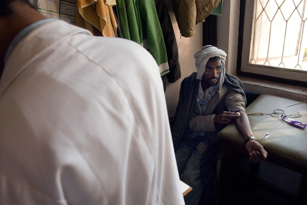 At Tekku hospital, Narayan having is blood taken for an HIV test.
