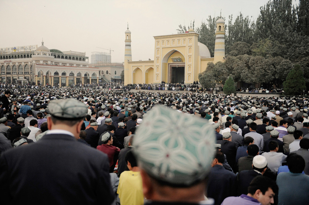 "A huge crowd of Uighurs has gathered in front of Id Kah mosque in Kashgar for Eid prayers. The mosque is already full and people are be praying outside. In July 2014 the Imam of the mosque who had supported the Communist party was stabbed to death by assailants. Imam Tahir was frequently quoted by state media praising the party and condemning separatists. In 2010 he told a meeting at the annual session of the NPC: ""Some hostile forces in and outside China have made use of religion to carry out penetration, sabotage and secessionist activities in Xinjiang, and they also sowed discord between religious people and non-religious people. So we must keep vigilance."""