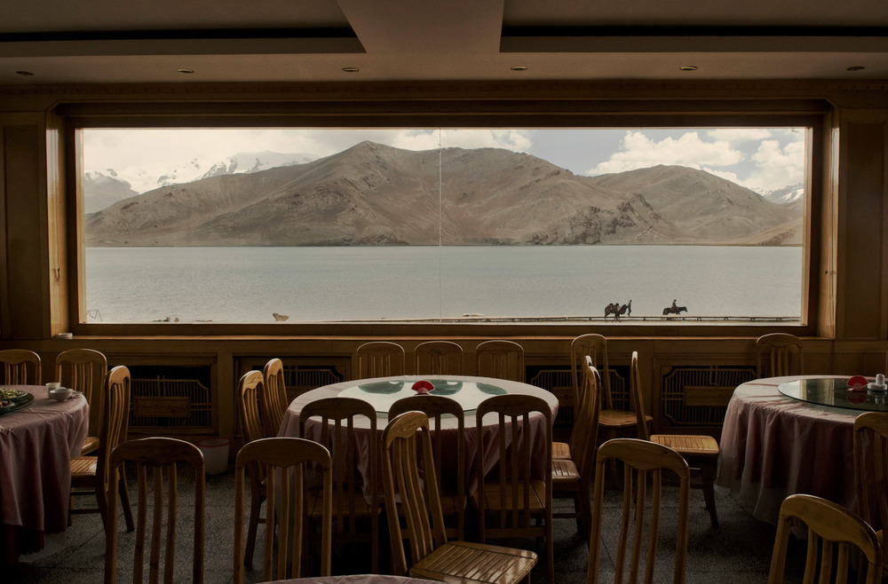An empty restaurant room by the Karakol Lake. The tourism industry in Xinjiang has been badly hit by the resurgence of violence since 2009. Many Chinese fear visiting the region in spite of its reputation for splendid landscape and exotic culture. In 2014 Beijing decided to award a 500RMB (80US$) incentive to each and every Chinese tourist visiting the region.