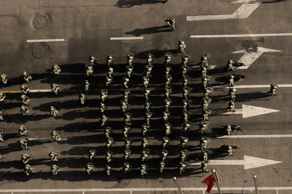 A group of the People's Armed Police is marching on the streets of Urumqi 3 days after the 2009 riots which claimed the life of over 200 Han people.