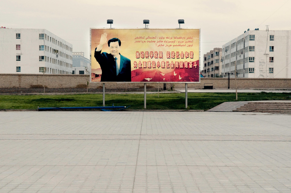 A propaganda poster commemorating President Hu Jintao visit to the city is displayed on Yarkand main square which was built over the ruins of the old city.