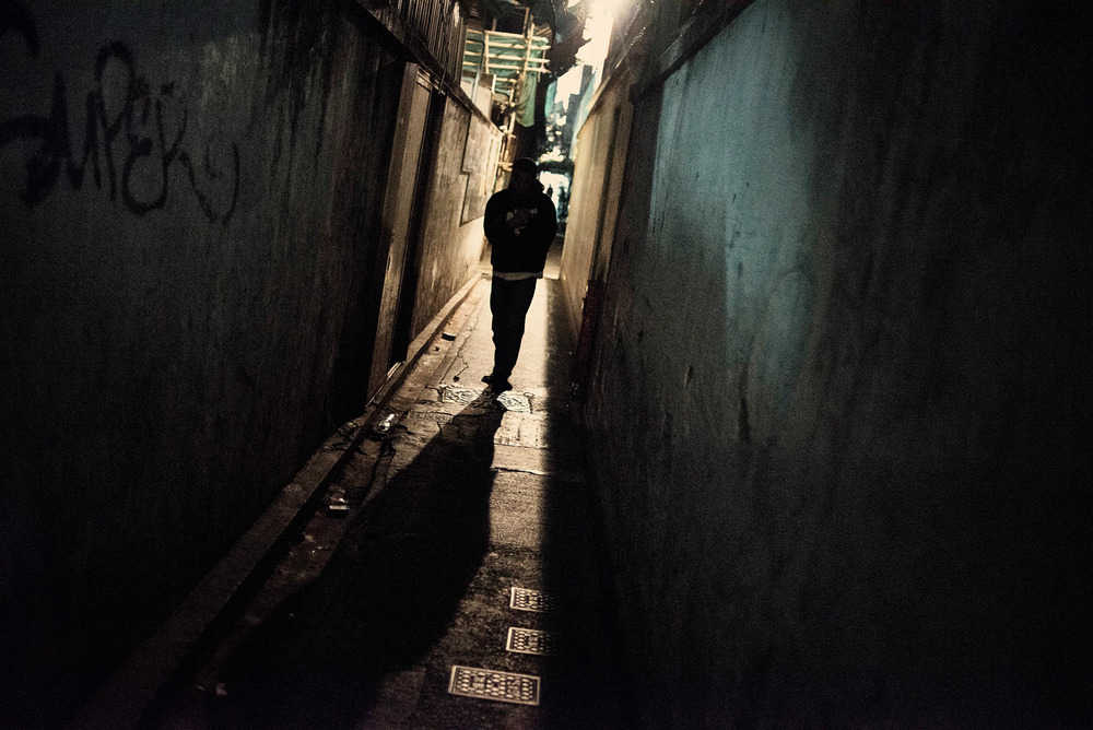 At night, a back alley leading to the Chungking Mansions.