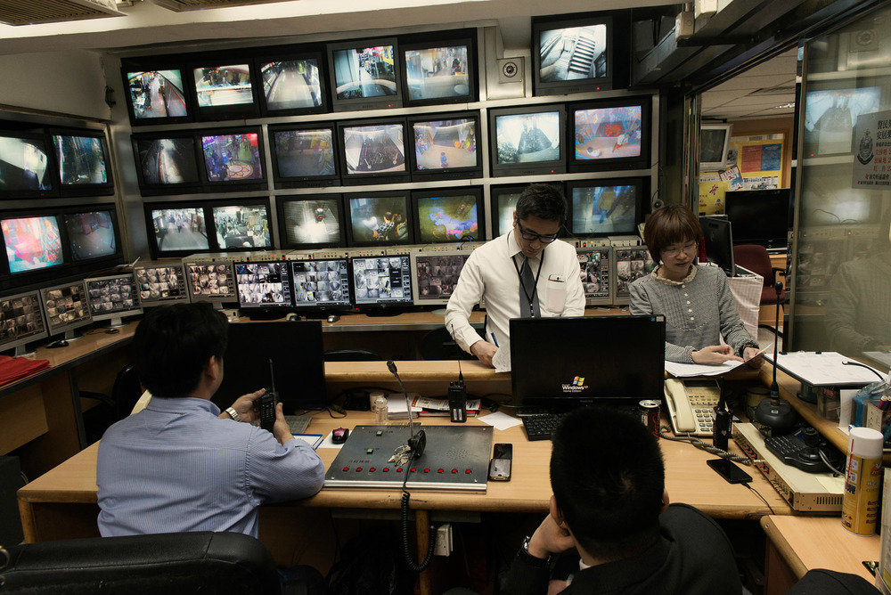 Inside the control room of the Chungking Mansions tv monitors linked to the 320 CCTV cameras which have been set up throughout the building. The Hong Kong police regularly sits in this room to monitor the activity inside the Chungking Mansions..