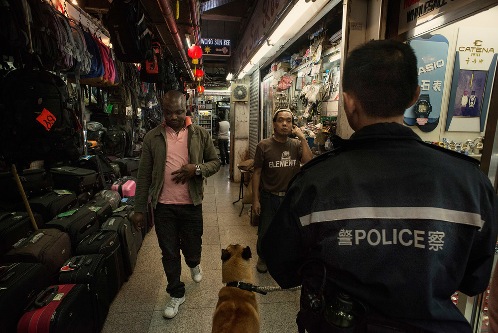A policeman making rounds in a commercial alley of the Chungking Mansions.The Chungking Mansions are seen by many Hong Kong people as place rife with crime, a reputation probably resulting from the high concentration of foreigners living or doing business there. The local police station has a team dedicated to the Chungking Mansions.