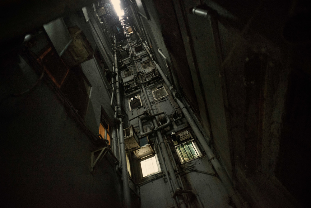 A shaft descending from the 17th floor of a Chungking Mansions block tower. Each tower has a few of these shafts which allow ventilation of the cramped inner buildings rooms and appartments..