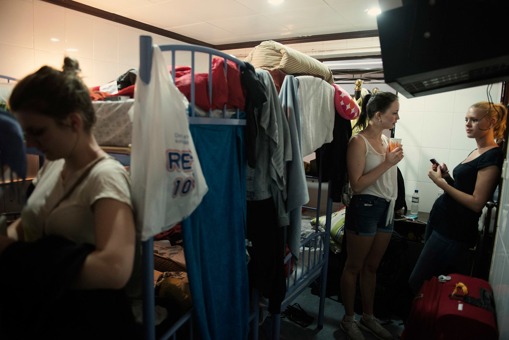 In a dorm of the Chungking Mansions, students from the Bergen School of Architecture in Norway, are resting before going out. They each pay about HK$80 (US$10) per nigh for a bunk bed. A bargain in Hong Kong which didn't make up for the presence of cockroaches and heavy noise coming from nightly renovation work in an adjacent hostel. The Chungking Mansions are very popular among budget travelers and backpackers. Several hostels there offer dorm beds.