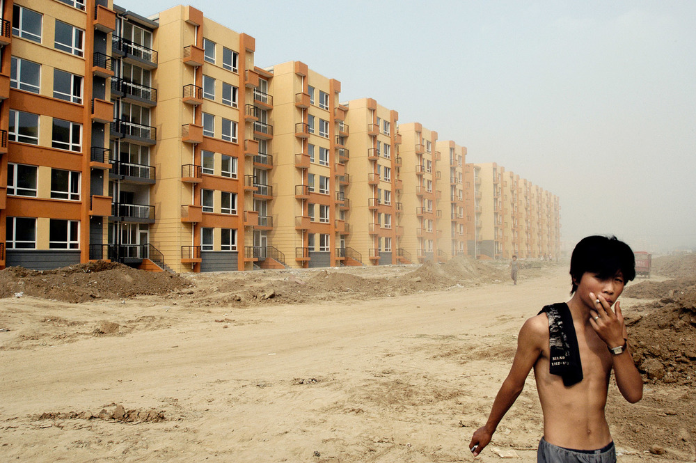 A worker by a construction site in Beijing.