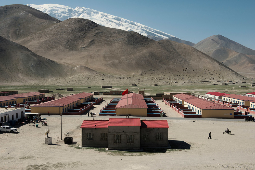 At the foot of the Mutzagh Ata mountain a Kyrgyz village with rows of newly built houses for nomads, part of nationwide plan to settle nomadic populations.