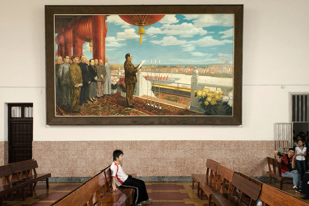 In the waiting room of Shaoshan (bithplace of Mao) railway station a huge painting showing Mao Tse Tung at Tian An Men announcing the creation of The People's Republic of China on October 1st 1949.