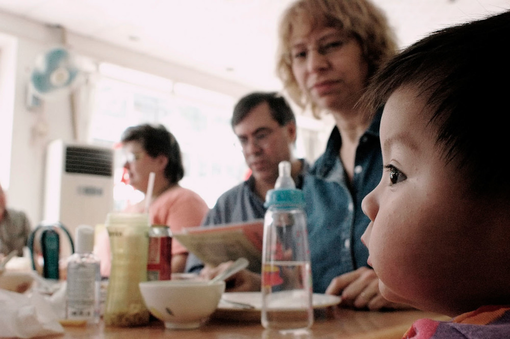 Lisa and Ralph Brown are having lunch with Alison their second adopted daughter. It is their second day together.