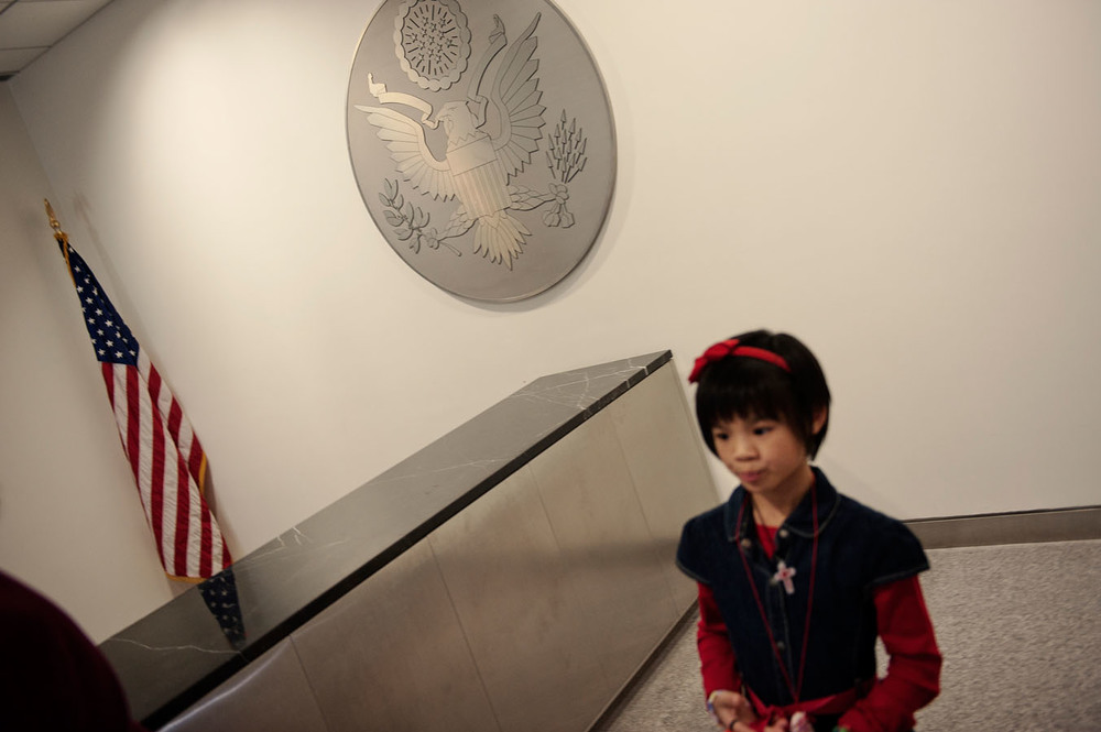 Maylinn at the U.S. consulate in Guangzhou after the oath ceremony that made her a citizen of the United States, a country where she is going to set foot for the first time in 36 hours.