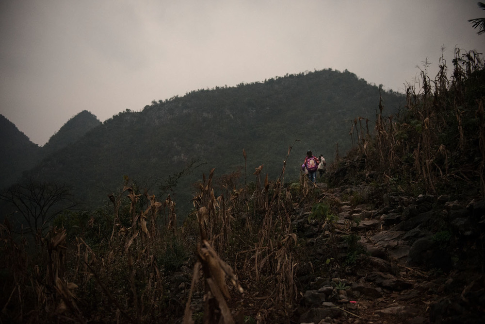 At 7 am, Tian Mei and her sisters are off to school an hours walk away along a mountain dirt path.