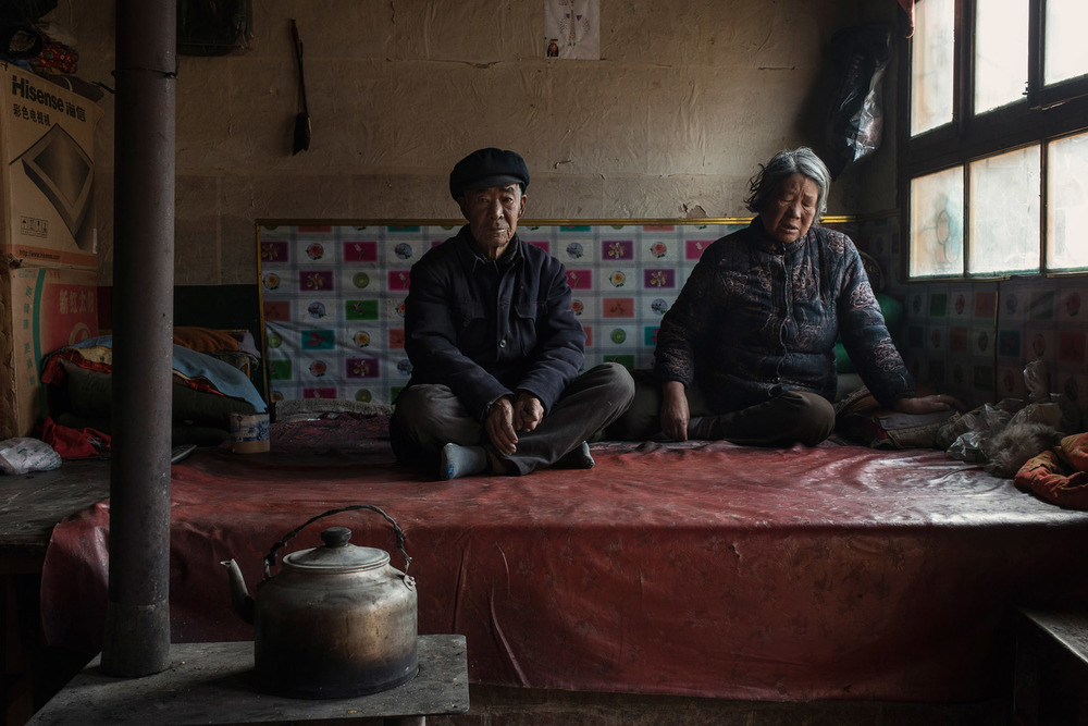 Baituo village  72 years old Yao Gouwa,  with his wife, Liu Yinxiang, also 72. She is pain from hypertension. Liu is in pain from hypertension, a very common affliction among elders in the region.