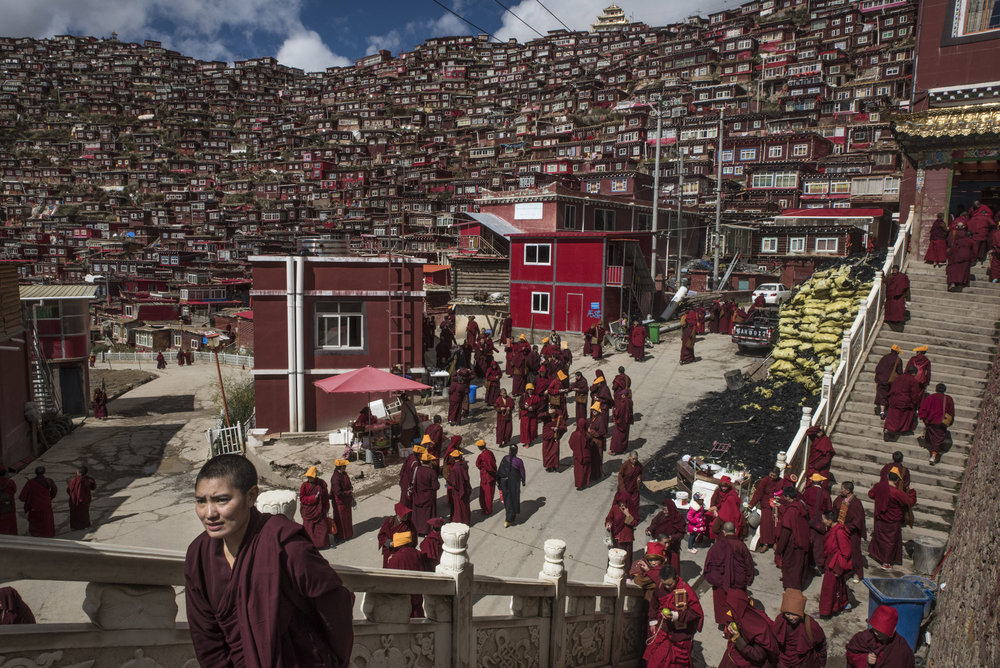 Nuns heading for prayers in Yarchen Gar.   Larung Gar was founded in 1980 by Jigme Phuntsok, a charismatic lama, and it swelled for two decades as word of his teachings spread. Credit