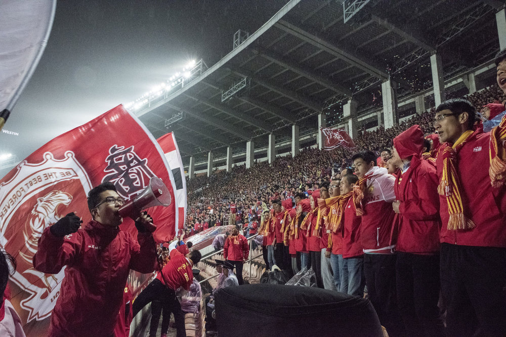 At The Guangzhou Tianhe stadium Evergrande supporters cheering during a Chinese League game against Changcun Yatai F.C..