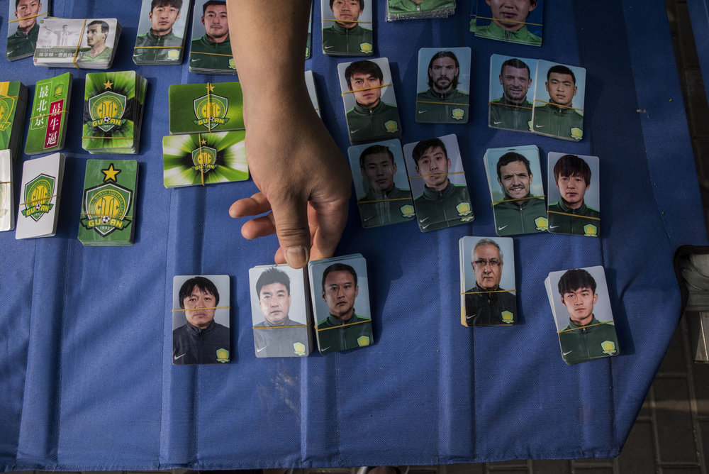 Outside the Workers Stadium in Beijing, a booth selling players stickers to supporters.