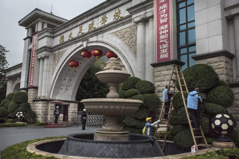 Gardeners working at the entrance gate of the Evergrande Football School, the world's biggest soccer boarding school and a showcase for China's ambitions to groom talents of international caliber.