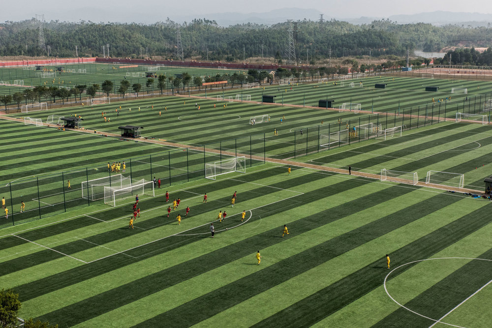 Students at the Evergrande Football School playing soccer during the training classes. The school counts 48 football pitches