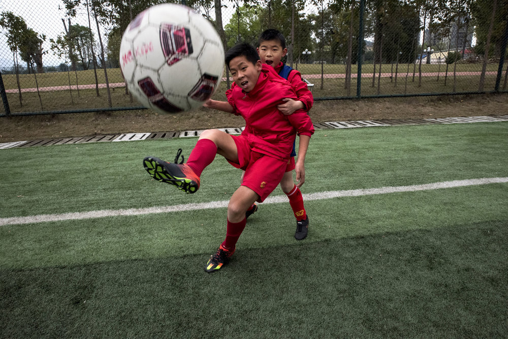 Students of the Evergrande football school training.