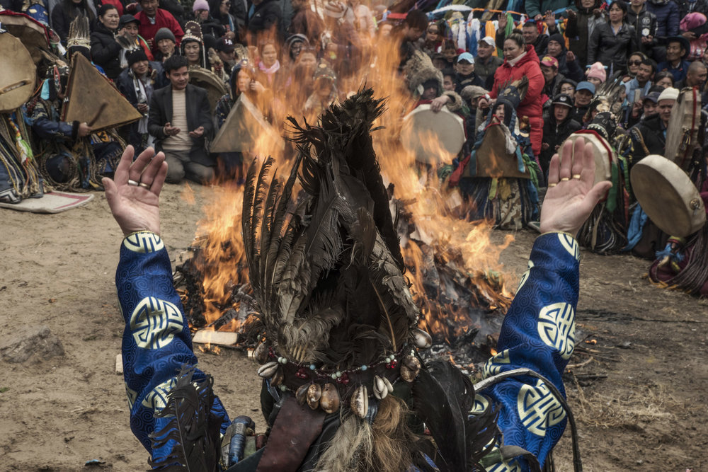 During a celebration of spring a shaman chanting his palms opened to the sky in front of a fire. Fire is a key element of shamanic rituals, it belongs to the arch of the sky and symbolizes the sun.   Some say the avent of shamanic rituals coincided with the human mastering of fire.