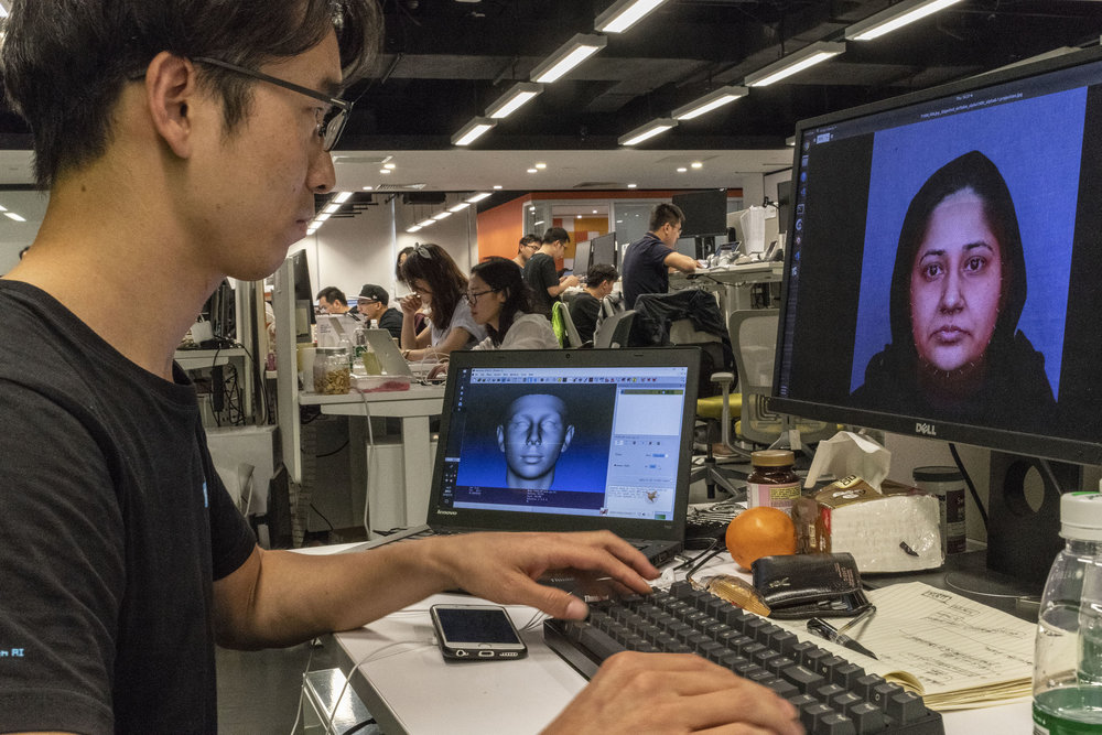 A programmer working on a facial recognition software at the offices of Face++ headquarters in Beijing.