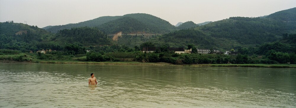 The inhabitants of Dachang, an historic village, are enjoying their last summer by the Danning river a subsidiary of the Yangtze. In the summer of 2006 the village was flooded, and the inhabitants moved away from the river to a new city.