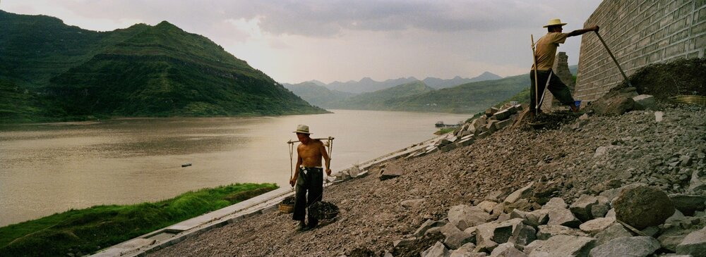 Workers consolidating the banks of the Yangtze ahead of the waters rise.