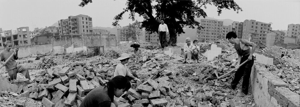 Workers picking up bricks from the ruins of residential buildings in Fengdu old city. The old city of Fengdu will be razed down before the 3 gorges reservoire rises.