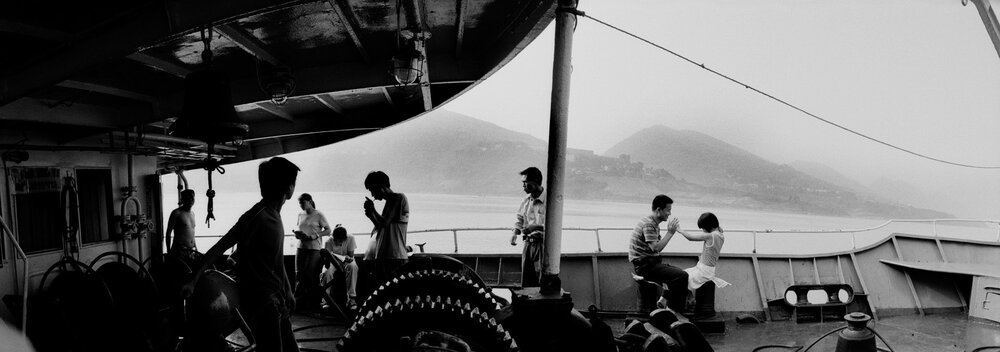 Passengers on a boat to heading to Chongqing. Over 1 million people have left their hometown along the river as their area is to be flooded by the rising water level. They sometimes had to relocate thousand miles away.