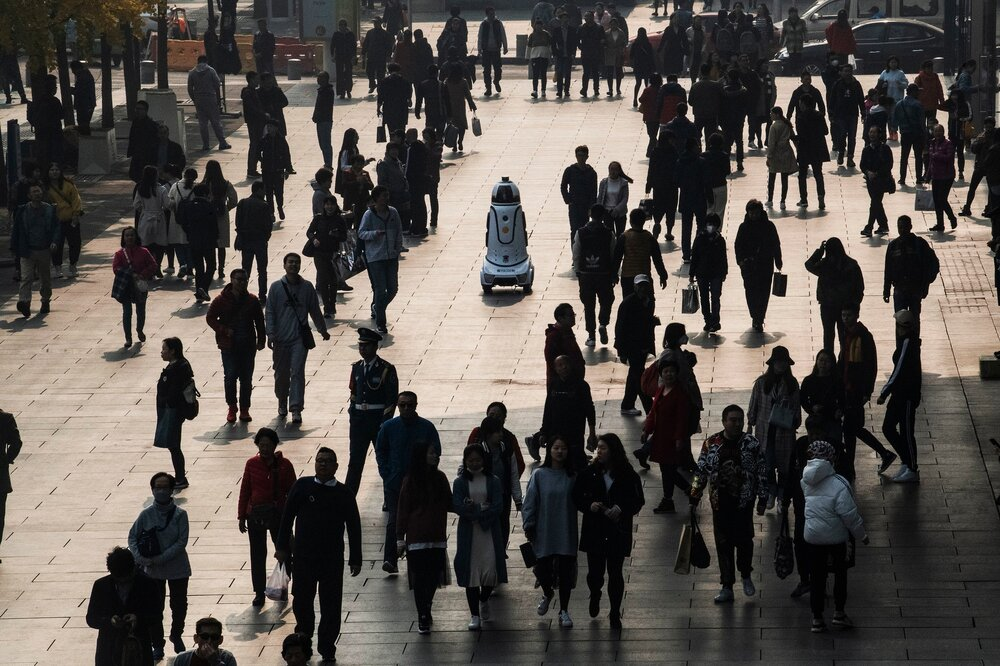 A police robot equipped with surveillance cameras on patrol in a commercial street of Beijing. This robot, connected to the city surveillance system can scan people within a radius of 800 m (2600 feet).