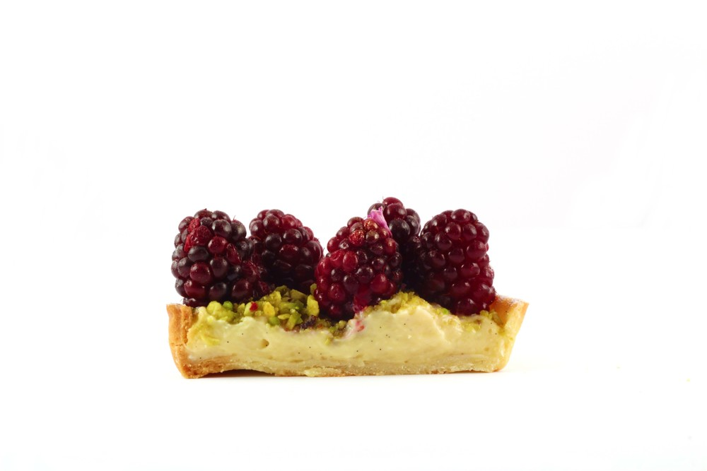 pistachio and boysenberry tart half.jpg
