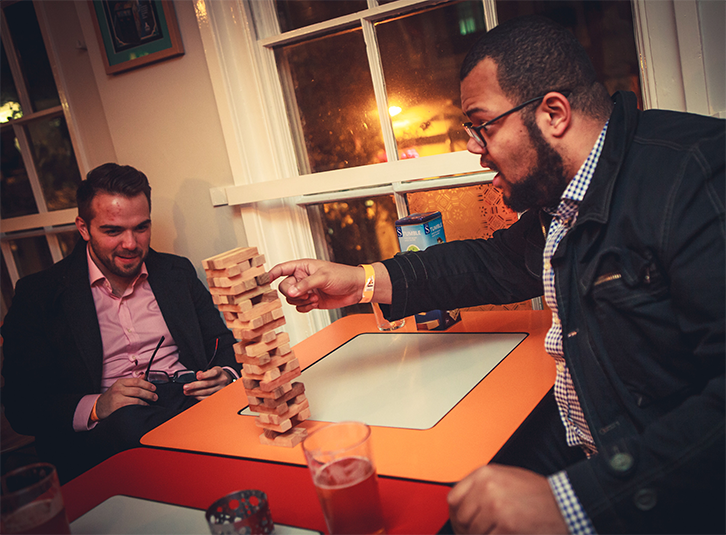 The Cordius team enjoying a precarious game of Jenga at the #NottTechParty
