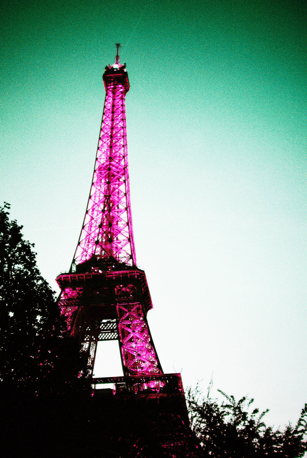 The Eiffel Tower at night on that Lomo Purple film.