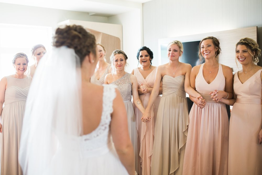 "Erin wanted to do a ""first look"" with all of her girls. Their reaction was just the best. You can just tell her beauty just left them speechless or in tears!"