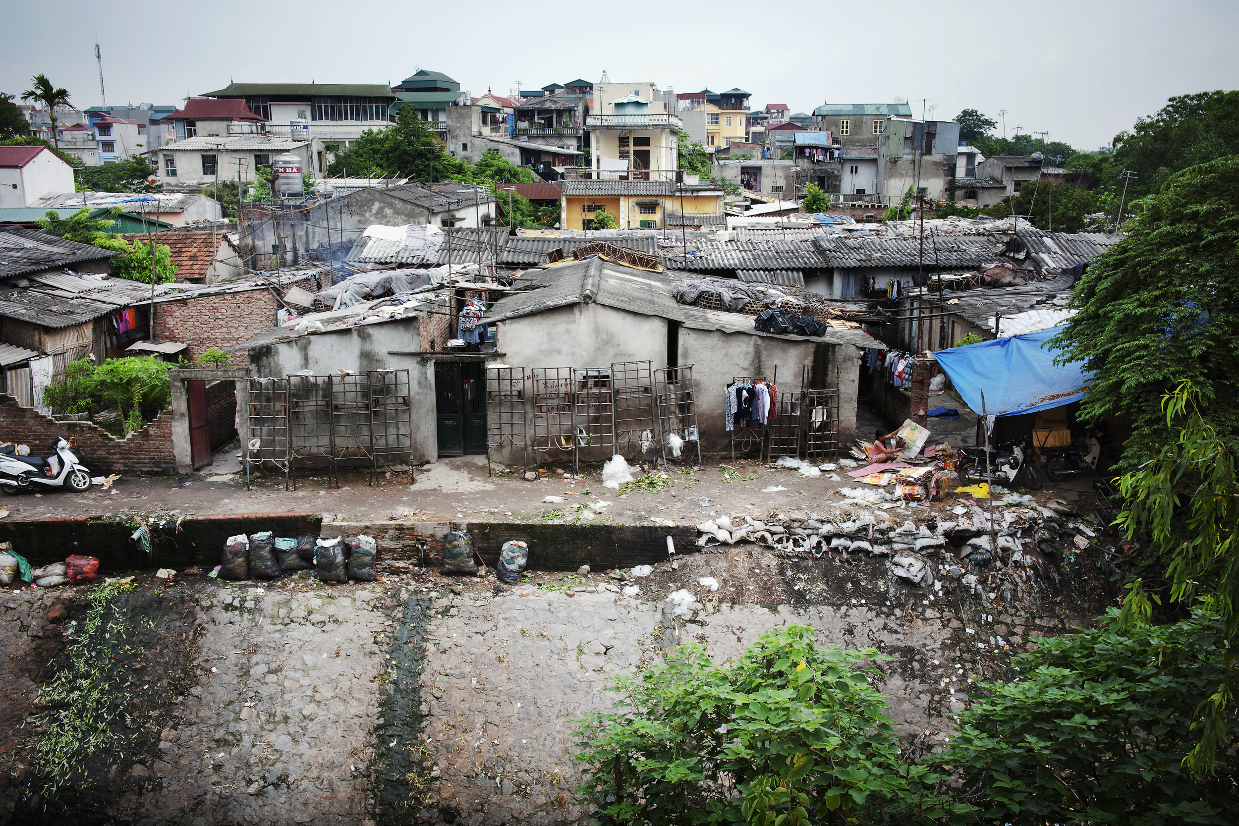 An urban slum in Hanoi, Viet Nam. According to the World Bank, over 13 percent of Viet Nam's population, and a quarter of the world population – nearly 2 billion people – live on $1.25 or less a day.  Photo Credit:  Kibae Park/UN Photo