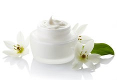 cosmetic-cream-white-jar-flowers-white-background-40316381.jpg