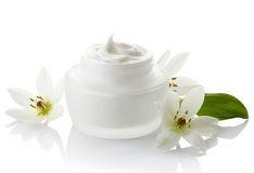cosmetic-cream-white-jar-flowers-white-background-40316381.jpg