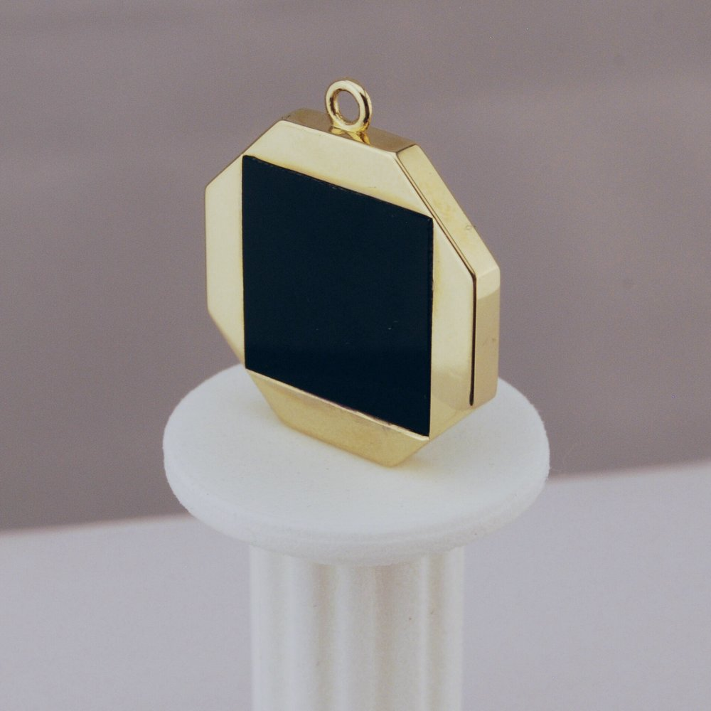 Custom 10k gold hexagon pendant with flush set onyx.