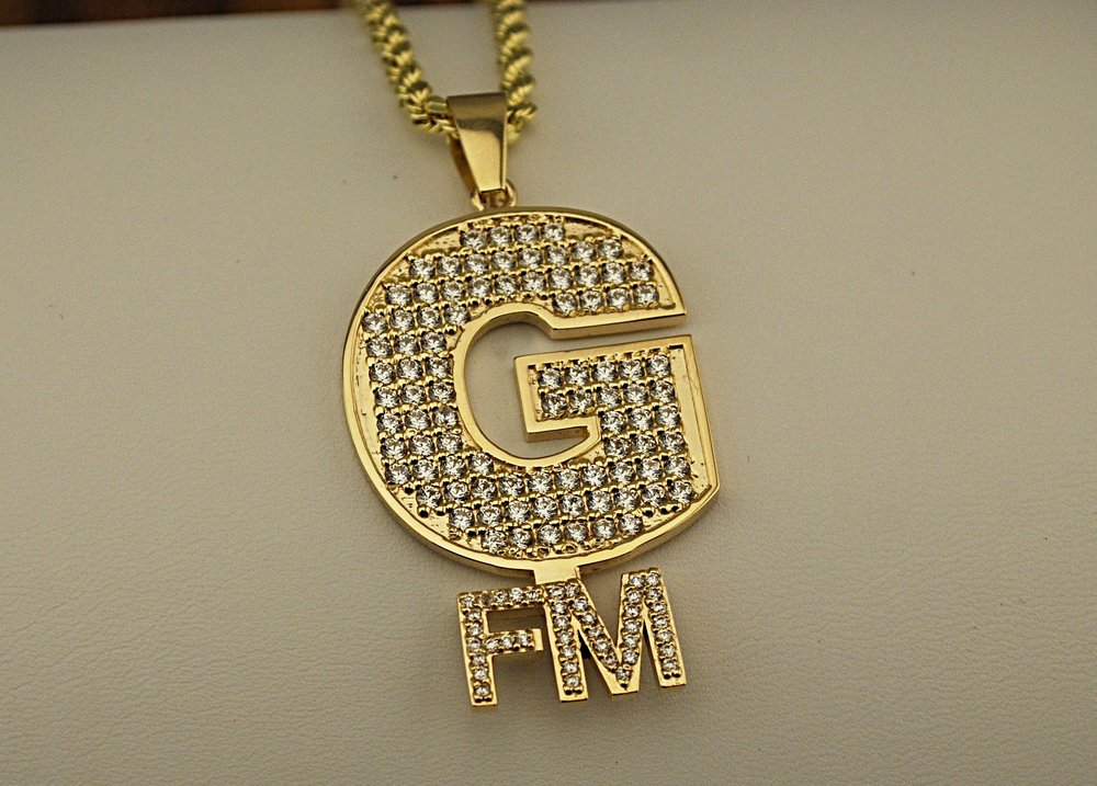 """Custom """"GFM"""" 14k gold pendant with diamonds and 14k rope chain."""