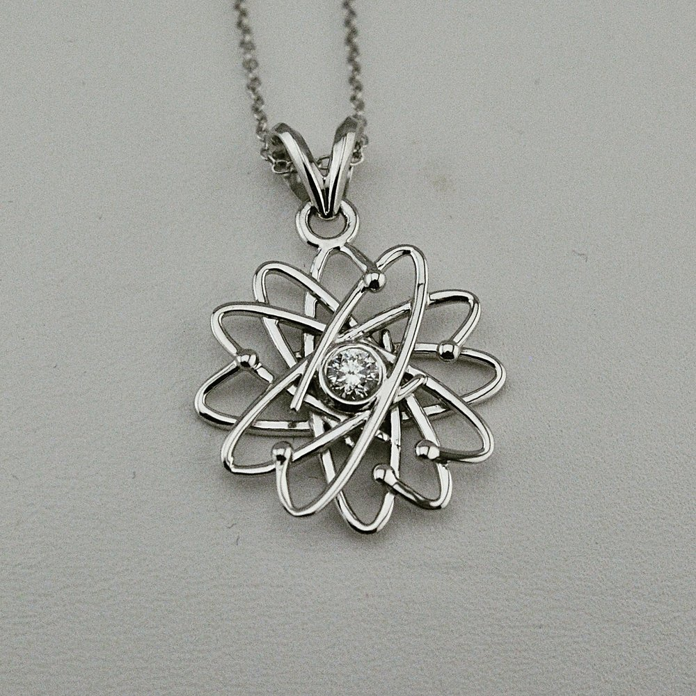 10k white gold atom pendant with genuine diamond.