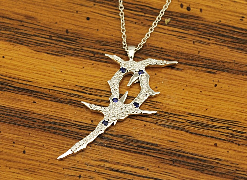 Custom 18k white gold logo engagement pendant with genuine diamonds.