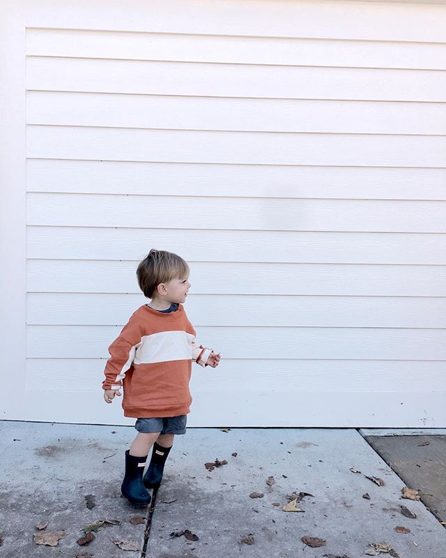 My boy...ketchup on his sweatshirt, a found lucky penny clutched in his hand (don't offer to hold it for him...I learned the hard way), rain boots on even though it's not raining, + running away from daddy pretending to be a t-rex. He's so two and I love it. #thisistwo #friendofarq