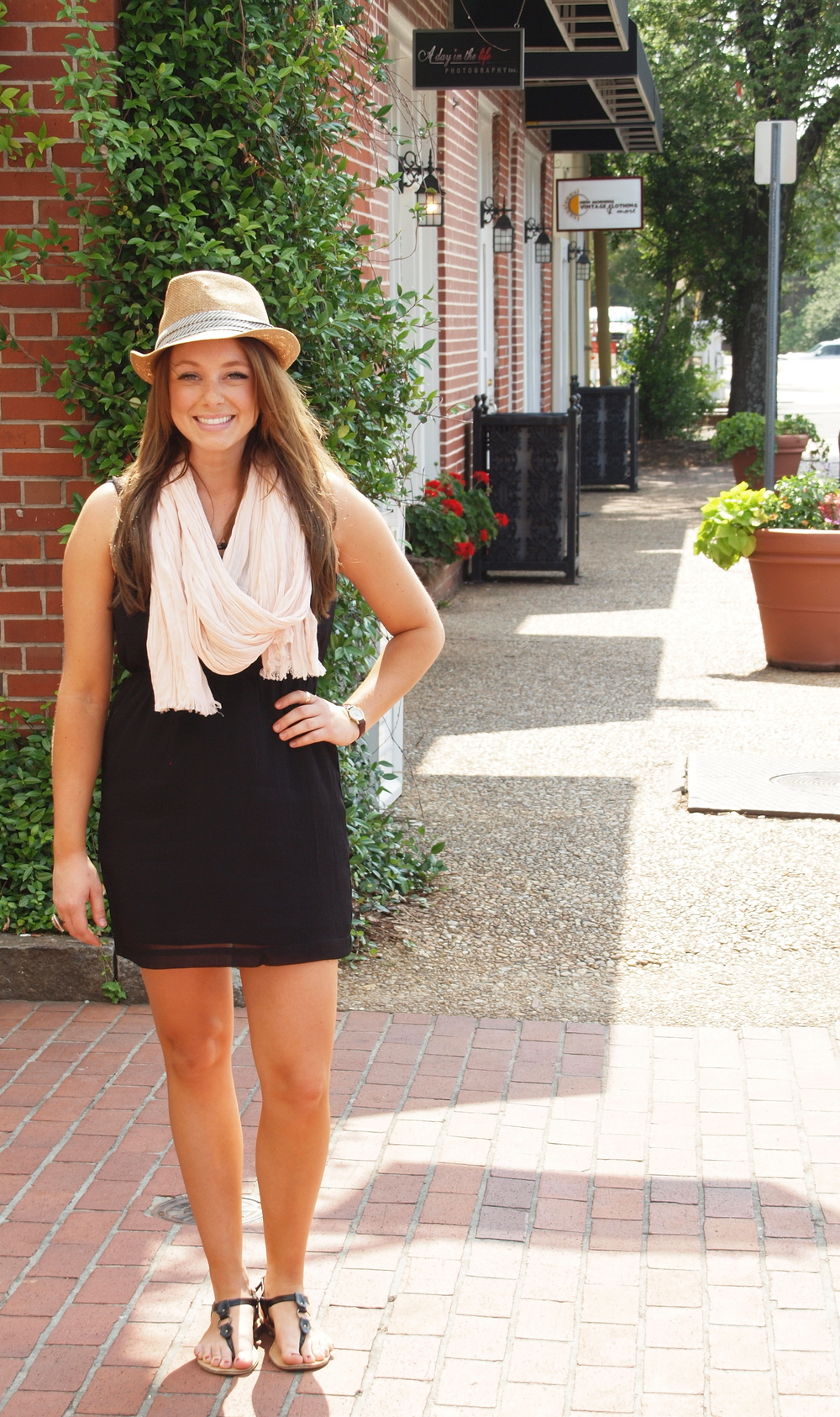 Girl wearing fedora