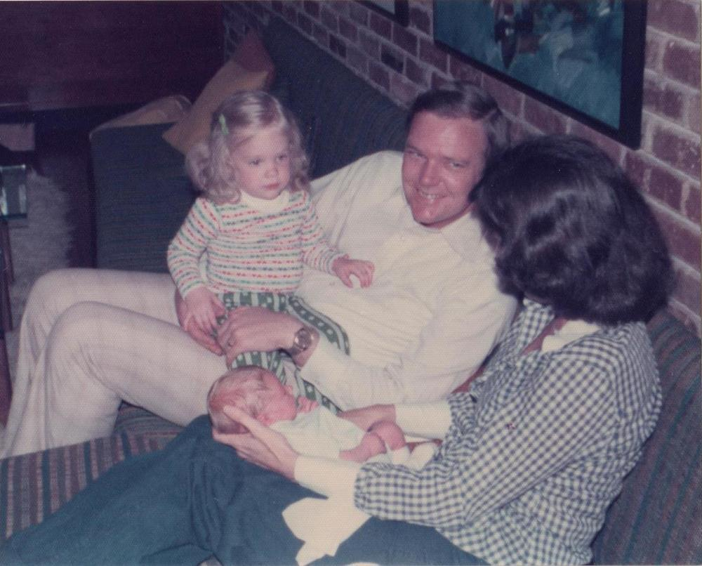 This is a photo of my parents introducing me to my new baby brother.  I was not happy.  I think I have gotten better at meeting new people and at putting together outfits...although the stripes going both ways is pretty awesome.