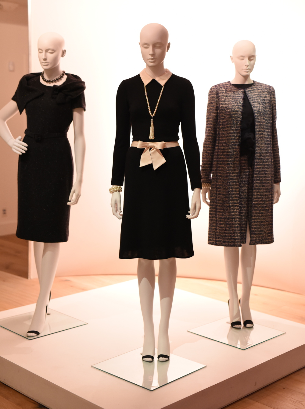 The dress in the middle is from Oscar de la Renta's first collection in 1965.